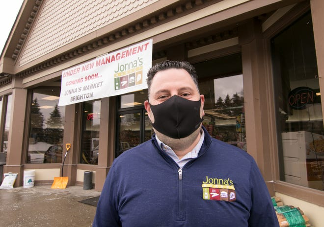 Jonna's Market co-owner Mike Jonna stands in front of the former Vic & Bob's Party Store on Chilson Road in Genoa Township Wednesday, Jan. 20, 2021.