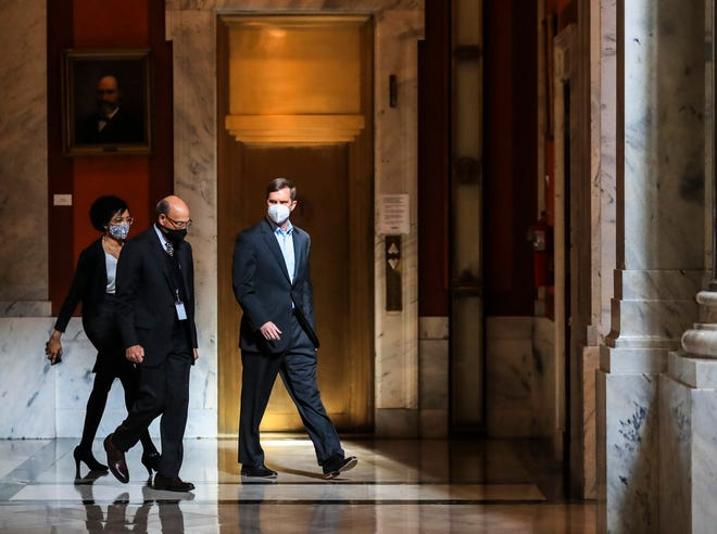 Gov. Andy Beshear walks toward his office after watching the inauguration of President Joe Biden and Vice President Kamala Harris on Wednesday inside the Capitol. Jan. 20, 2021