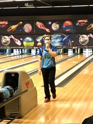 River Valley girls bowler Alexis Manning competes while wearing a mask during this week's match with Marion Harding at Bluefusion.