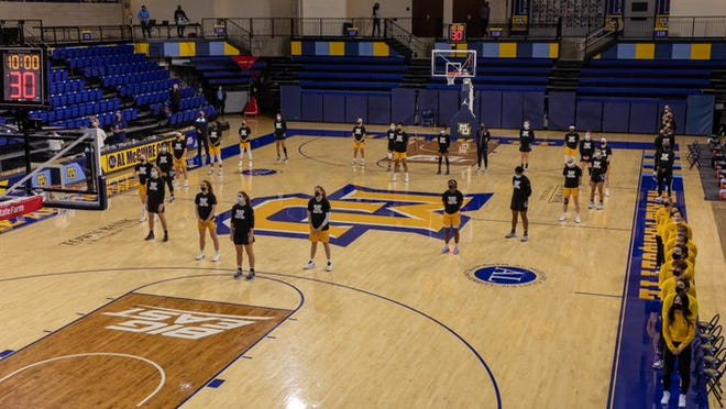 The Marquette and Georgetown women's basketball teams lined up in the shape of a heart before their game on Wednesday.