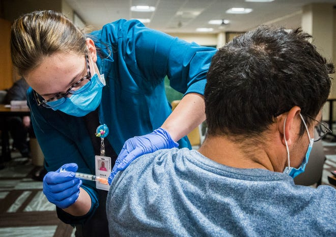 Healthcare workers and state residents aged 70 or older receive the Moderna COVID-19 vaccine at the Open Door Health Clinic on Madison Street in downtown Muncie back in February.