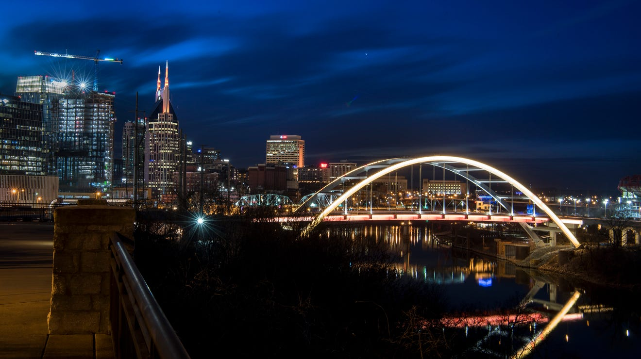 Photos: Korean Veterans Memorial Bridge lit amber in the National COVID-19 Memorial