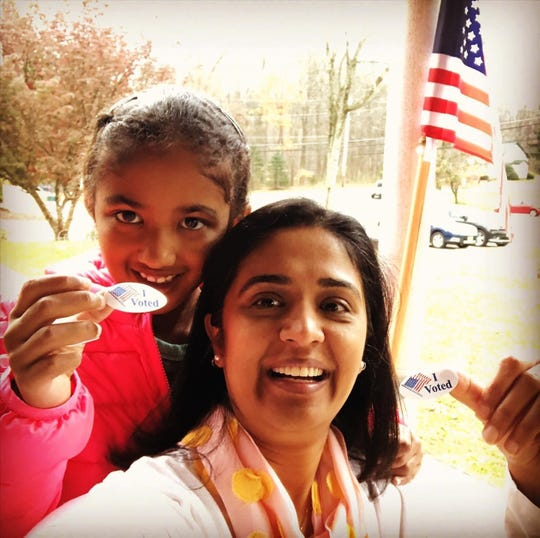 "Rupande Mehta, of Denville, and daughter, Sophie Mehta Heholt, take a picture after Mehta voted in the 2020 presidential election. On Wednesday, when Vice President Kamala Harris was sworn in as the first woman, Asian American and African-American to hold the post, Sophie said she was a ""mini"" Kamala Harris."