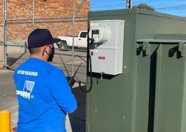PNM meter reader Luis Apodaca goes about his business in Silver City, NM.