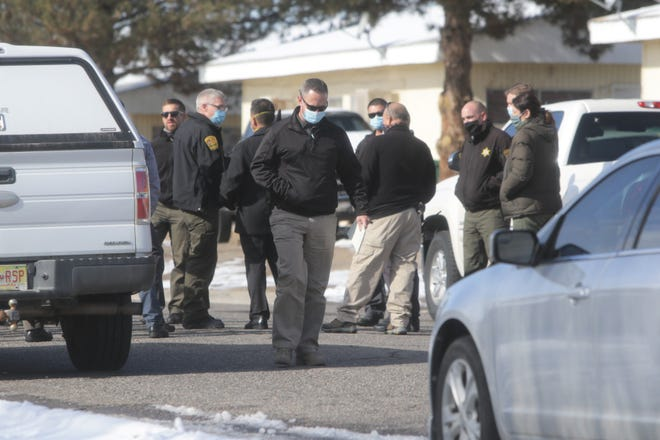Area law enforcement officers respond to an officer-involved shooting on the morning of Jan. 20 in the 1000 block of Glade Lane. A suspect was transported to the hospital with injuries.
