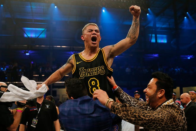 JoJo Diaz celebrates after defeating Tevin Farmer in a unanimous decision to win the IBF 135 World Title at Meridian at Island Gardens on January 30, 2020 in Miami, Fla.