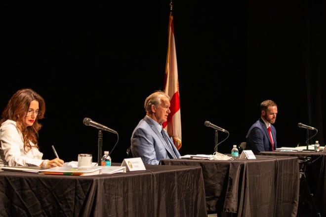 Sen. Doug Broxson speaks, as Rep. Michelle Salzman and Rep. Alex Andrade listen during an Escambia County legislative delegation meeting Tuesday, Jan. 19, 2021.