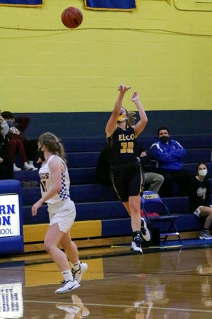 Elco's Amanda Smith heaves up a half court shot that goes in as the buzzer sounds at the end of the 3rd quarter.