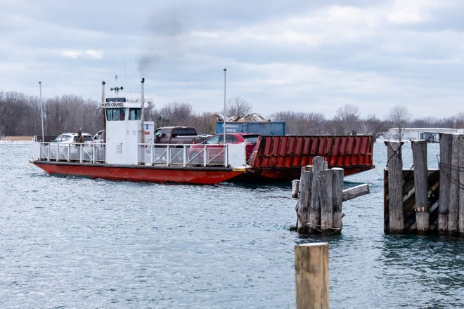 One of the Champion's Auto ferries departs the dock in Clay Township for Harsens Island Wednesday, Jan. 20, 2021.