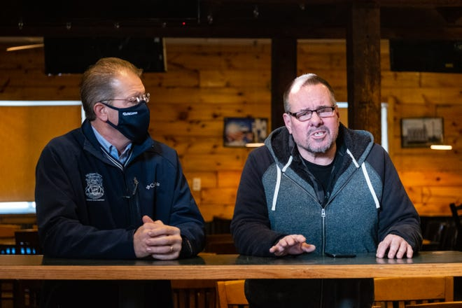 Sen. Dan Lauwers, left, listens at a press conference with Dave Scholz, owner of Roadhouse 19, Wednesday, Jan. 20, 2021, in Yale. Lauwers held three press conferences with restaurant owners in the 25th Senate District to discuss how Gov. Whitmer's continued lockdown has affected the livelihoods of workers.