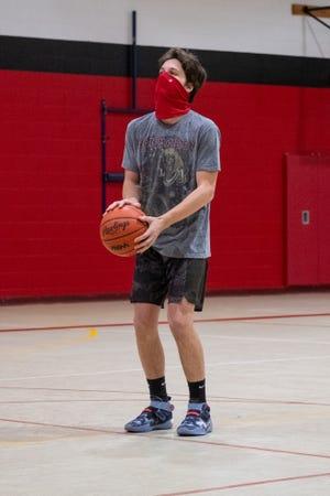 Port Huron senior Ethan Balon prepares to make a free throw during practice Tuesday, Jan. 19, 2021, at Port Huron High School.
