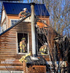 Firefighters work at the scene of a fire on Steltz Road in Shrewsbury Township Wednesday, Jan. 20, 2021. Bill Kalina photo