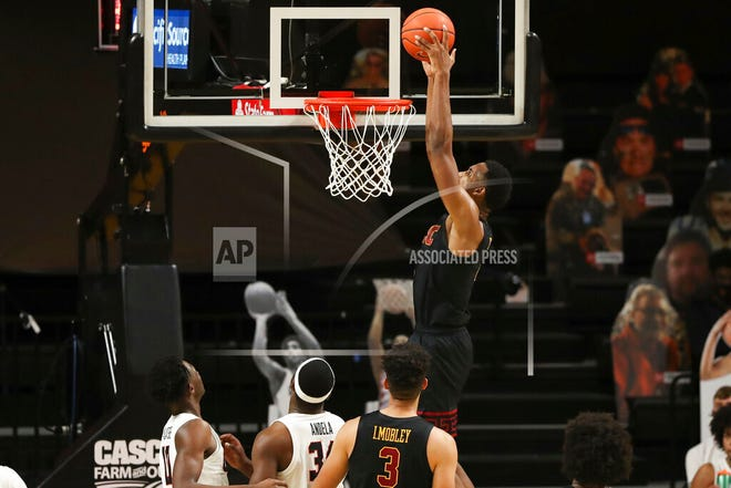 Southern California's Evan Mobley (4) dunks against Oregon State during the first half of an NCAA college basketball game in Corvallis, Ore., Tuesday, Jan. 19, 2021.