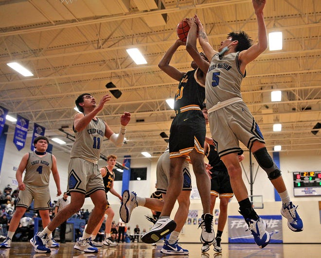 Lake View's Santos Rangel, right, attempts to block a shot during a boys basketball game against Snyder on Tuesday, Jan. 19, 2021.