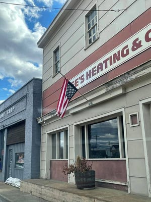 Flag displayed upside down in front of Lee's Heating and Cooling