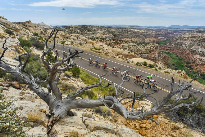 FILE - In this Aug. 2, 2016, file photo, cyclists race along the scenic Byway 12 above the Grand Staircase-Escalante National Monument during the Tour Of Utah bike race. President Joe Biden said Wednesday, Jan. 20, 2021, he plans to review the Trump administration's downsizing of the Grand Staircase-Escalante and Bears Ears National Monuments in southern Utah. (Francisco Kjolseth/The Salt Lake Tribune via AP, File)