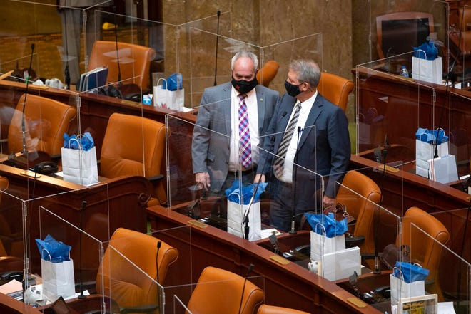 Members of the House of Representatives are partitioned by plexiglass as the Utah State Legislature opens the 2021 legislative session at the Capitol in Salt Lake City on Tuesday, Jan. 19, 2021. (Francisco Kjolseth/The Salt Lake Tribune via AP)