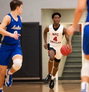 North Florida Christian's Traylon Ray (4) brings the ball down the court. NFC beat Arnold 57-50 Tuesday, Jan. 19, 2021.