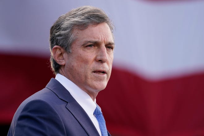 "Delaware Gov. John Carney speaks at the Major Joseph R. ""Beau"" Biden III National Guard/Reserve Center, Tuesday, Jan. 19, 2021, in New Castle, Del."