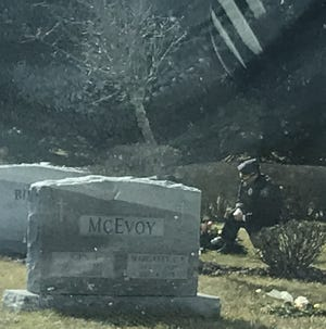 While Joe Biden gave his inauguration speech on Wednesday afternoon, a lone person in a uniform kneeled at the grave of Biden's son Beau Biden at St. Joseph on The Brandywine church in Greenville, Delaware.