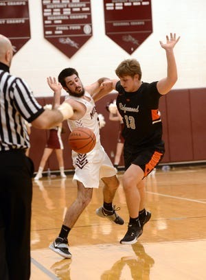 John Glenn's Avery Parmer, left, tries to dribble around Ridgewood's Kadin Bradford during the first half of the Muskies' 56-49 loss on Jan. 19 in New Concord.