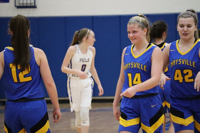 Maysville's Bailee Smith is congratulated by teammates after setting the school's all-time scoring record in Tuesday's game at Philo. Smith had 16 points in a 40-30 win.