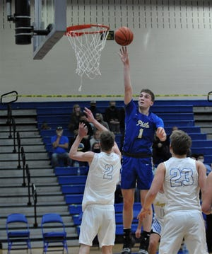 Philo's A.J. Clayton puts up a shot in Tuesday's game at Maysville. The Panthers won 59-57 in overtime.