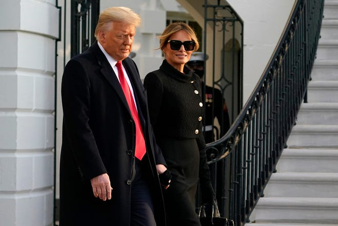 President Donald Trump and first lady Melania Trump leave the White House for the last time in his term Jan. 20, 2021.
