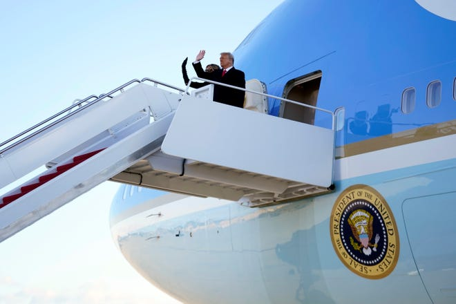 President Donald Trump and first lady Melania Trump board Air Force One at Andrews Air Force Base, Md., Jan. 20, 2021.