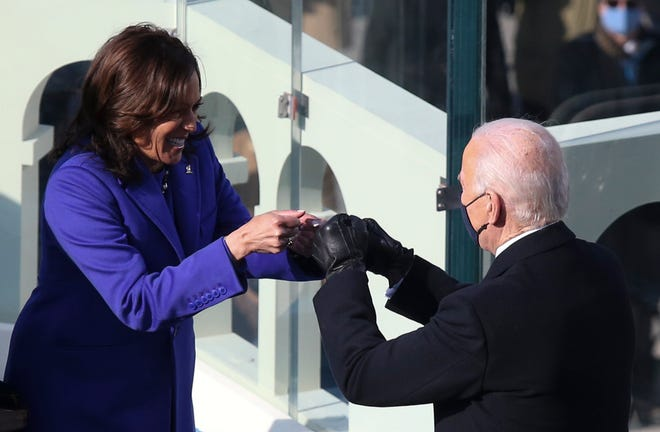 Vice President Kamala Harris bumps fists with President Joe Biden after she took the oath of office Jan. 20 at the U.S. Capitol.
