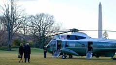 President Donald Trump and first lady Melania Trump walk to board Marine One on the South Lawn of the White House, Jan. 20, 2021, in Washington. Trump is en route to his Mar-a-Lago Florida Resort.