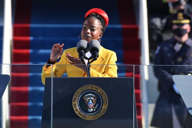"Amanda Gorman, 22, reads her inaugural poem ""The Hill We Climb"" during the 2021 Presidential Inauguration of President Joe Biden and Vice President Kamala Harris at the U.S. Capitol."