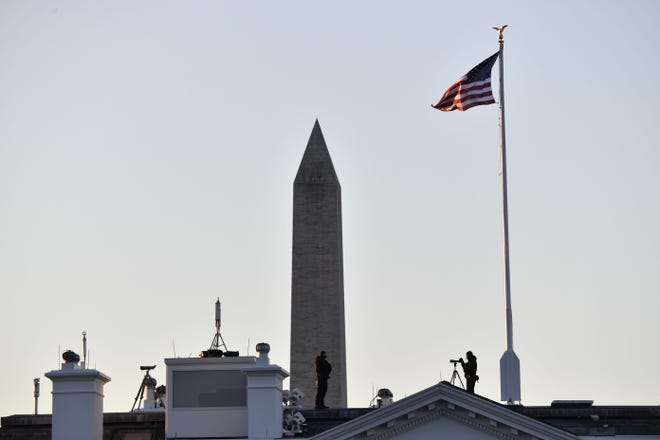 Security is posted atop the White House in Washington, D.C. as Marine One is scheduled to depart the White House in Washington, D.C., en route Joint Base Andrews, Maryland on January 20, 2021.