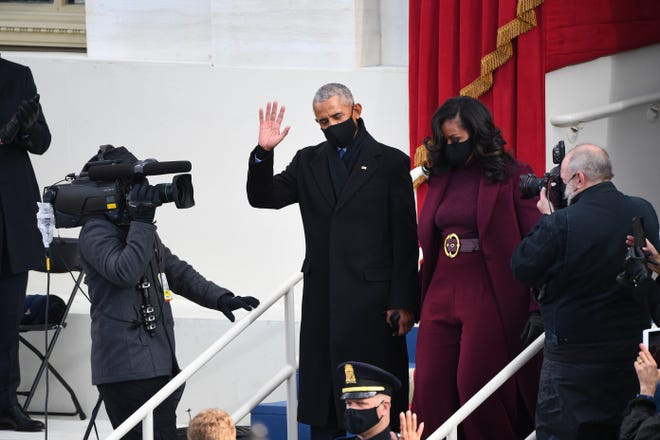 Former President Barack Obama and Michelle Obama arrive before the 2021 Presidential Inauguration of President Joe Biden and Vice President Kamala Harris at the U.S. Capitol.