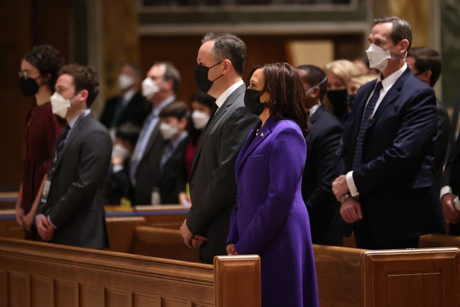 Vice President-elect Kamala Harris (R) and her husband Doug Emhoff (L) attend services at the Cathedral of St. Matthew the Apostle on Jan. 20, 2021 in Washington, DC.