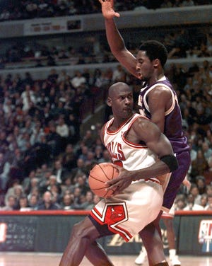 Chicago's Michael Jordan is guarded by Los Angeles' Kobe Bryant in the second half on Dec.. 17, 1997 in Chicago