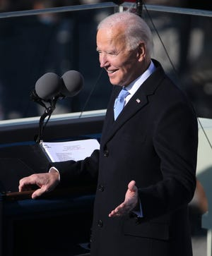 President Joe Biden gestures to stage members before delivering his inaugural address during the 2021 Presidential Inauguration of President Joe Biden and Vice President Kamala Harris at the U.S. Capitol.