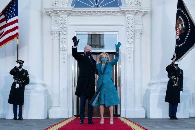 President Joe Biden and first lady Jill Biden arrive at the White House on Inauguration Day, Jan. 20, 2021.