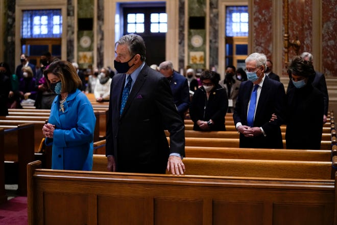 House Speaker Nancy Pelosi and her husband Paul Pelosi and Senate Minority Leader Mitch McConnell and his wife Elaine Chao attend Mass at the Cathedral of St. Matthew the Apostle during Inauguration Day ceremonies Wednesday, Jan. 20, 2021, in Washington.