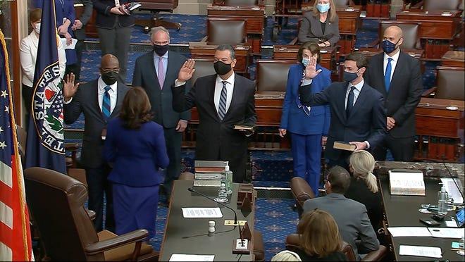 Vice President Kamala Harris swears in Sens. Raphael Warnock, D-Ga.; Alex Padilla, D-Calif.; and Jon Ossoff, D-Ga., on the floor of the Senate on Jan. 6 in Washington.