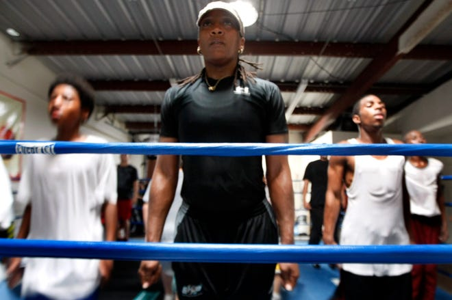 Austin boxer and trainer Ann Wolfe, shown working with low-income and at-risk kids in her East Austin gym in 2009, will be inducted into the International Boxing Hall of Fame this summer.