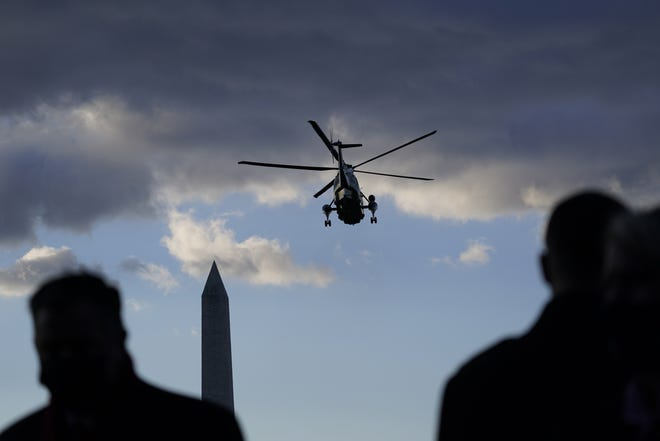 People watch as Marine One with President Donald Trump on board departs the White House on Wednesday. [AP PHOTO/ALEX BRANDON]