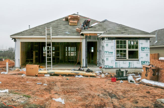 A construction crew works on a new home in Southeast Austin. The Austin City Council on Thursday gave preliminary approval to doubling thecity's homestead exemption from 10% to the state maximum of 20%. The exemption would apply only to property tax paid to the city of Austin, not to school districts and other taxing entities.