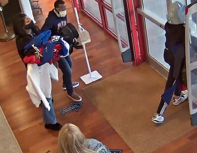Security camera footage shows suspected shoplifters leaving a Polo store in Commerce with their arms loaded with merchandise. [Jackson County Sheriff's Office photo]