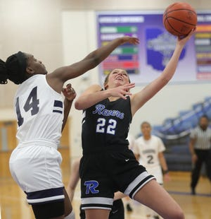 Twinsburg's Logan Pride defends a shot in the paint by Revere's Adison Novosel on Wednesday, Jan. 20, 2021 in Twinsburg, Ohio. [Phil Masturzo/ Beacon Journal]