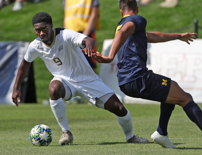 University of Akron forward David Egbo (9) was drafted by the Vancouver Whitecaps in the first round (ninth overall) of the MLS Draft on Thursday. [Jeff Lange/Beacon Journal]