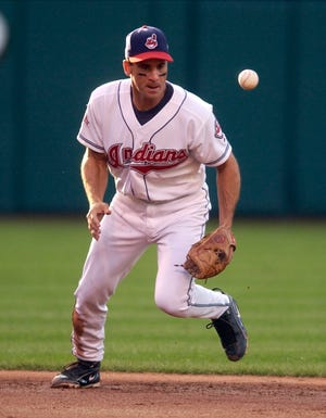 Cleveland Indians shortstop Omar Vizquel keeps an eye on the ball after bobbling it in the second inning Wednesday, Aug. 11 , 2004, in Cleveland. Vizquel was able to make the throw to first base to get Toronto Blue Jays' Frank Menechino.