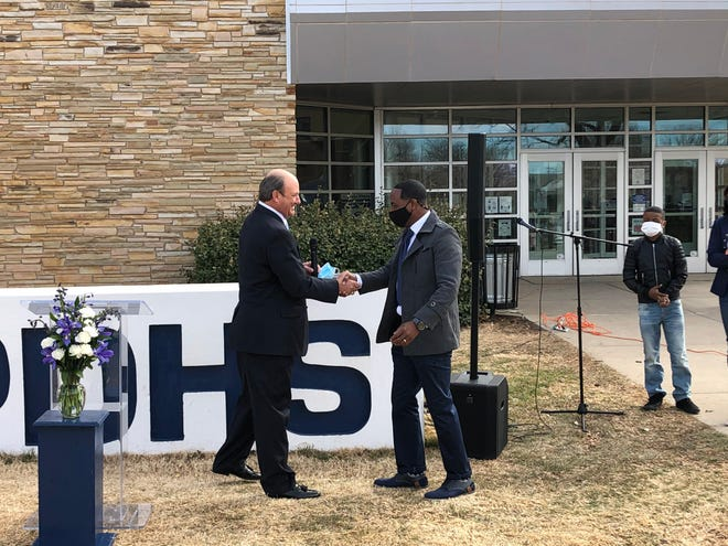 Amarillo ISD Athletic Director Brad Thiessen (left) welcomes Eric Mims as the new Head Football Coach at Palo Duro High School.