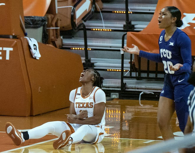 Texas guard Joanne Allen-Taylor celebrates after she drew an offensive foul against TCU's Lauren Heard in Wednesday's 71-54 win at the Erwin Center.