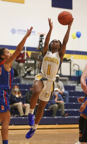 Streetsboro junior Mariah Embry leaps up for a shot during the basketball game against Ravenna High School, Wednesday, January 20, 2021.